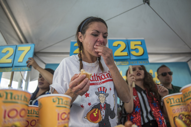 No. 7 ranked eater in the world Michelle Lesco competes during the Nathan's Famous Hot Dog Eating Contest qualifier at the Brooklyn Bridge at New York-New York hotel-casino in Las Vegas on Saturda ...