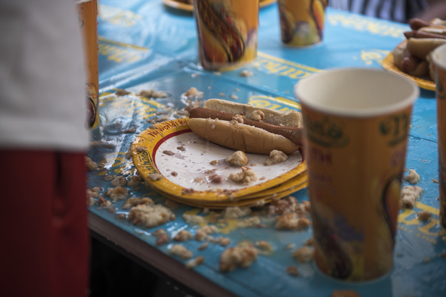 A competitor's plate is seen during the Nathan's Famous Hot Dog Eating Contest qualifier at the Brooklyn Bridge at New York-New York hotel-casino in Las Vegas on Saturday, April 23, 2016. (Martin  ...