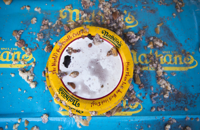 An empty plate is seen after the completion of the Nathan's Famous Hot Dog Eating Contest qualifier at the Brooklyn Bridge at New York-New York hotel-casino in Las Vegas on Saturday, April 23, 201 ...