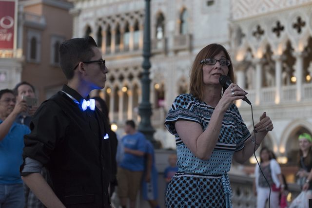 Melanie Bash, VP of fundraising and development with Grant a Gift Autism Foundation, right, speaks during an event put on by the foundation to celebrate World Autism Awareness Day at the Venetian  ...