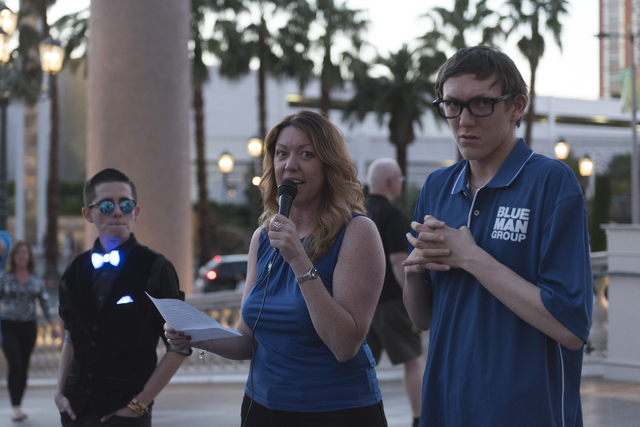Lynda Tache, founder and CEO with Grant a Gift Autism Foundation, center, speaks during an event put on by the foundation to celebrate World Autism Awareness Day at the Venetian in Las Vegas Satur ...
