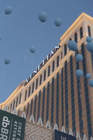 Approximately 80 balloons are released during an event put on by Grant a Gift Autism Foundation to celebrate World Autism Awareness Day at the Venetian in Las Vegas Saturday, April 2, 2016. The Ve ...