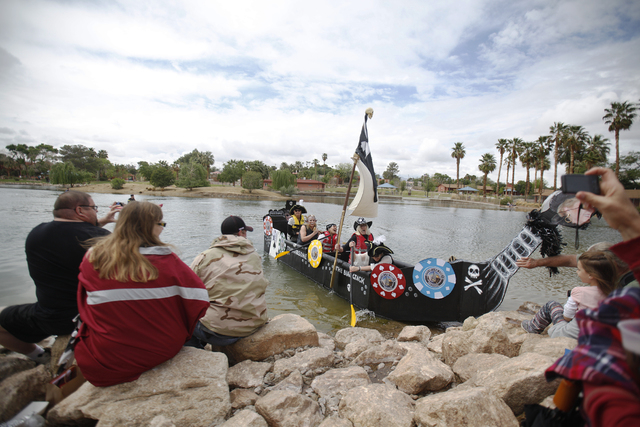 Team Marrsome's boat runs ashore during the Cardboard Regatta at the Pirate Fest at Lorenzi Park in Las Vegas Sunday, April 10, 2016. (Rachel Aston/Las Vegas Review-Journal) Follow @rookie__rae