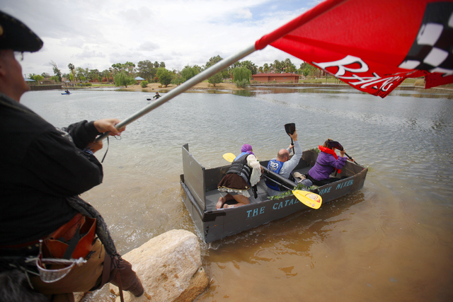 A team aboard the Catalina Wine Maker boat races in the Cardboard Regatta at the Pirate Fest at Lorenzi Park in Las Vegas Sunday, April 10, 2016. (Rachel Aston/Las Vegas Review-Journal) Follow @ro ...