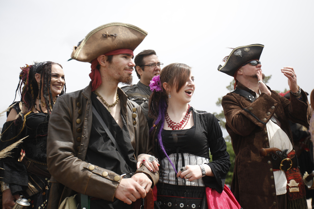 Danya Cornelius, from left, Sam Cornelius, Dan Richmond, Jennifer Berriola, and J.W. Cornelius watch the  Cardboard Regatta at the Pirate Fest at Lorenzi Park in Las Vegas Sunday, April 10, 2016.  ...