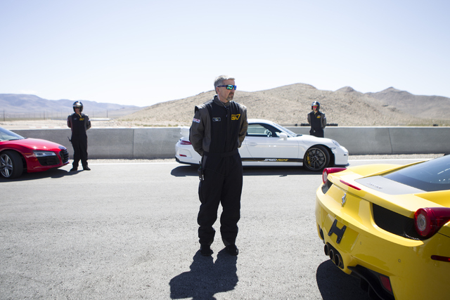 Driving coach Sean Lethbridge stands behind a car during the ceremonial track opening for SPEEDVEGAS on Friday, April 15, 2016, in Las Vegas. (Erik Verduzco/Las Vegas Review-Journal Follow @Erik_V ...