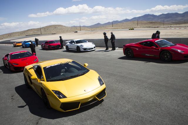 Exotic cars are seen during the ceremonial track opening for SPEEDVEGAS on Friday, April 15, 2016, in Las Vegas. (Erik Verduzco/Las Vegas Review-Journal Follow @Erik_Verduzco)