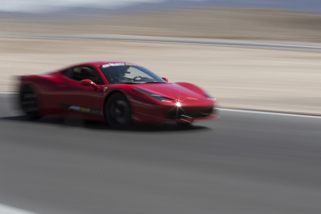 A driver takes a lap in a Ferrari 458 Italia during the ceremonial track opening for SPEEDVEGAS on Friday, April 15, 2016, in Las Vegas. (Erik Verduzco/Las Vegas Review-Journal Follow @Erik_Verduzco)
