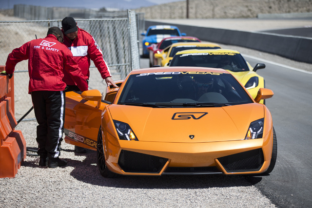 Exotic cars are seen lined up during the ceremonial track opening for SPEEDVEGAS on Friday, April 15, 2016, in Las Vegas. (Erik Verduzco/Las Vegas Review-Journal Follow @Erik_Verduzco)