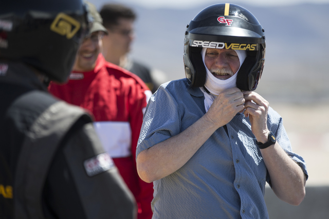 Mike Lee takes off his helmet after taking a lap in an exotic car during the ceremonial track opening for SPEEDVEGAS on Friday, April 15, 2016, in Las Vegas. (Erik Verduzco/Las Vegas Review-Journa ...