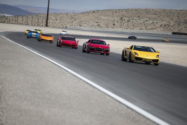 Drivers take a lap in exotic cars during the ceremonial track opening for SPEEDVEGAS on Friday, April 15, 2016, in Las Vegas. (Erik Verduzco/Las Vegas Review-Journal Follow @Erik_Verduzco)