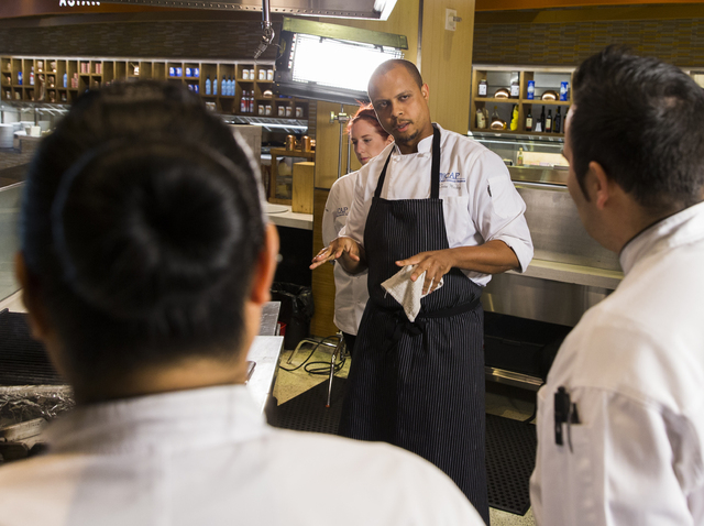 Sean Mackey, middle, a participant in the Culinary Associates Program, discusses the preparation of his salmon dish, Tuesday, April 19, 2016, at the Aria Resort & Casino in Las Vegas. Candidat ...