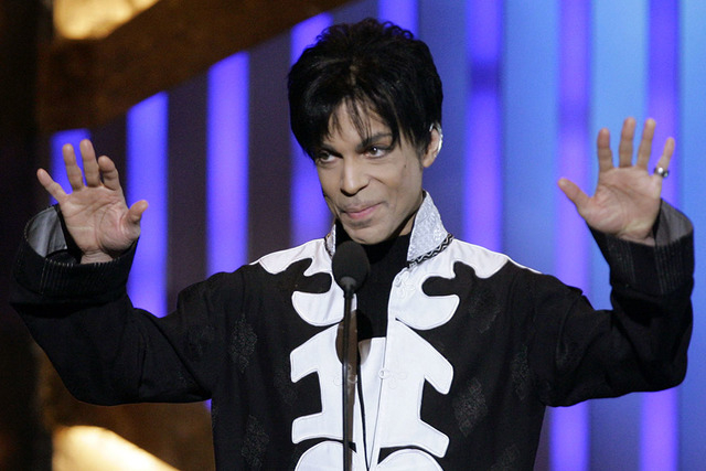 Prince accepts the award for outstanding male artist at the 38th NAACP Image Awards in this March 2, 2007 file photo, in Los Angeles. (AP Photo/CHRIS CARLSON, file)