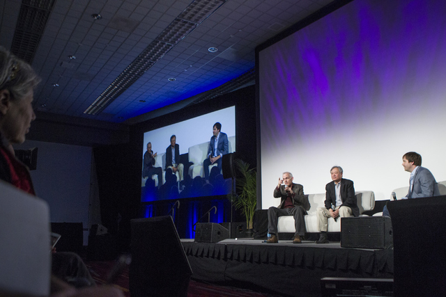 """Tim Squyres, from left, Ang Lee and Ben Gervais participate in the """"Pushing the Limits of Cinema"""" breakout session during the National Association of Broadcasters convention Saturday. (Erik Verduz ..."""
