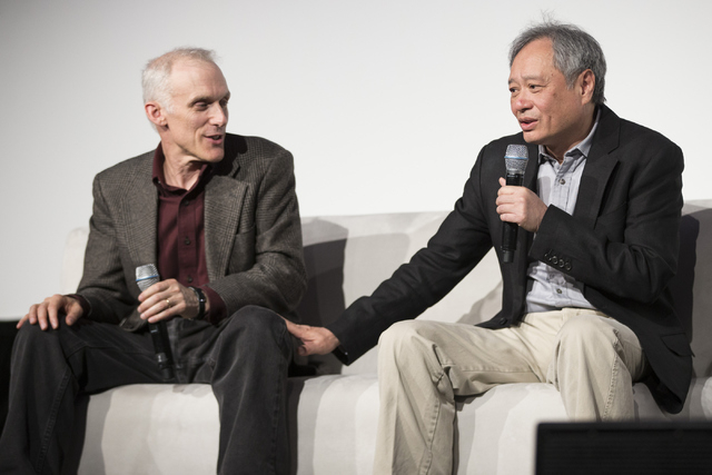 """Director Ang Lee, right, with editor Tim Squyres, speaks in the """"Pushing the Limits of Cinema"""" breakout session during the National Association of Broadcasters convention Saturday.  (Erik Verduzco ..."""