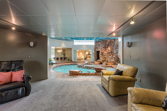 The centerpiece of the home is its indoor pool and spa.  (COURTESY OF LUXE ESTATES & LIFESTYLE)