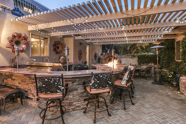 Florence Shapiro of Shapiro & Sher Group, Berkshire Hathaway HomeServices, Nevada Properties said most luxury homes have outdoor kitchens. This one is at Eagles Ridge. (COURTESY OF SHAPIRO &am ...