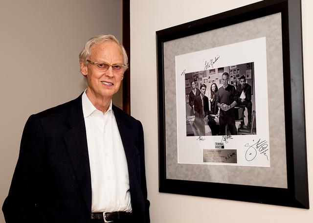 "Longtime Las Vegan and attorney John Gubler shows off a signed framed autographed photograph of ""Criminal Minds'""' first season cast. (TONYA HARVEY/REAL ESTATE MILLIONS)"