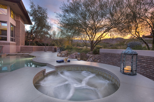 There is an outdoor pool and spa. (Synergy Sotheby's International Realty)