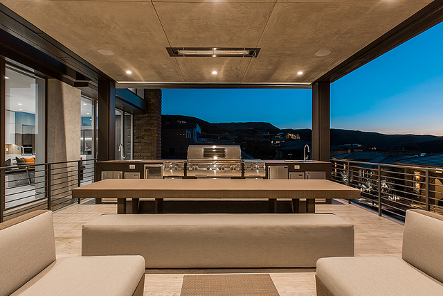 This home at MacDonald Highlands features a large outdoor kitchen with seating and a view of the Las Vegas Valley. (COURTESY OF SHAPIRO & SHER GROUP)