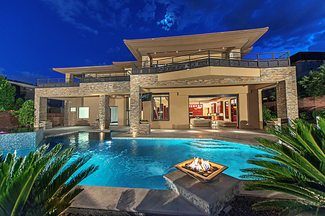 Backyard features include a pool, spa, swim-up bar, outdoor kitchen, four fire pits, 15-foot waterfall and views of the golf course and the city skyline.