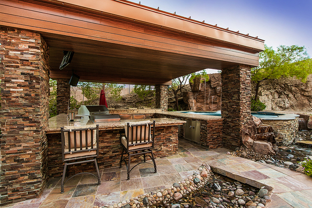 This outdoor kitchen has been designed incorporate the spa. (COURTESY OF SHAPIRO & SHER GROUP)