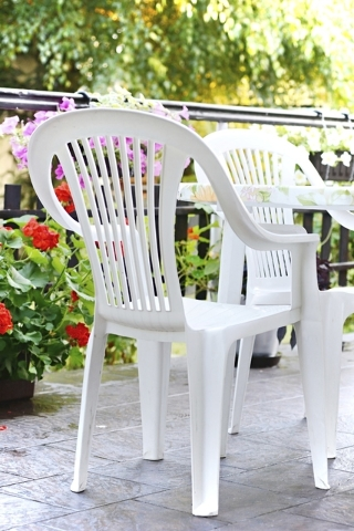 THINKSTOCK Plastic furniture that doesn't come clean with soap and water can be spray painted.