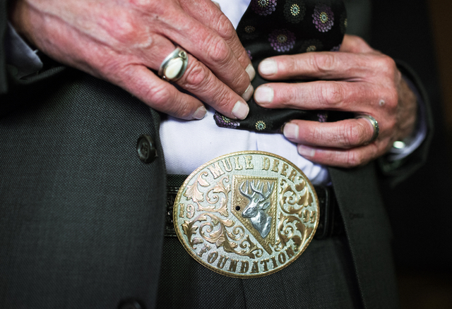 Funeral director and Hawthorne Justice of the Peace Jay T. Gunter, shows his belt buckle at Gunterճ Funeral Home in Hawthorne, Nev. on Thursday, April 7, 2016. Gunter is also Esmerelda Count ...