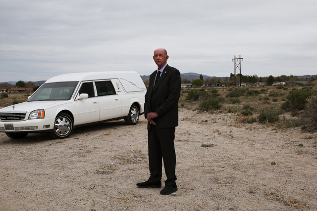 Funeral director and Hawthorne Justice of the Peace Jay T. Gunter, poses with his 2001 Cadillac funeral hearse at Gunterճ Funeral Home in Hawthorne, Nev. on Thursday, April 7, 2016. Gunter is als ...