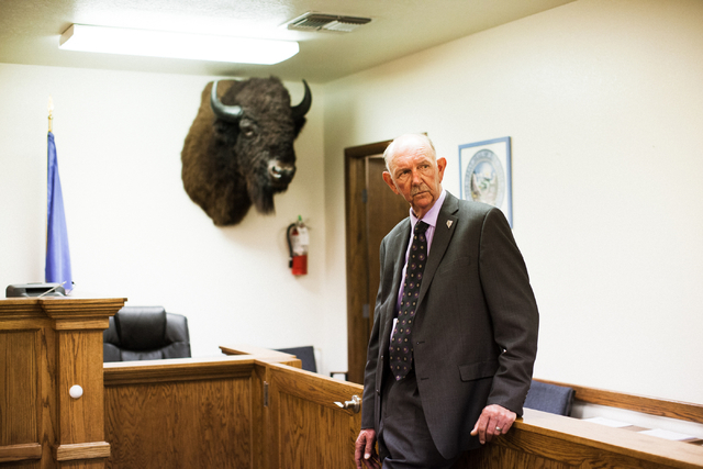 Funeral director and Justice of the Peace Jay T. Gunter, talks to a reporter in Hawthorne Justice Court in Hawthorne, Nev. on Thursday, April 7, 2016. Gunter is also Esmerelda Countyճ deputy coro ...