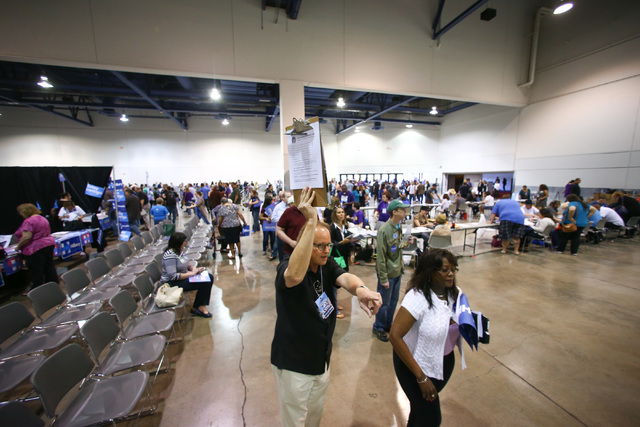 Roy Engelbretson directs delegates and alternates to register at the Clark County Democratic Party Convention at Cashman Center in Las Vegas on Saturday, April 2, 2016. (Chase Stevens/Las Vegas Re ...
