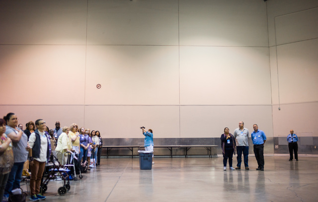 People stand as the national anthem is sung during the Clark County Democratic Party Convention at Cashman Center in Las Vegas on Saturday, April 2, 2016. (Chase Stevens/Las Vegas Review-Journal)  ...