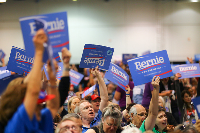 Supporters of Democratic presidential candidate Bernie Sanders cheer during the Clark County Democratic Party Convention at Cashman Center in Las Vegas on Saturday, April 2, 2016. (Chase Stevens/L ...