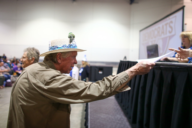 Thomas Kuretich hands in his delegate intent form during the Clark County Democratic Party Convention at Cashman Center in Las Vegas on Saturday, April 2, 2016. (Chase Stevens/Las Vegas Review-Jou ...