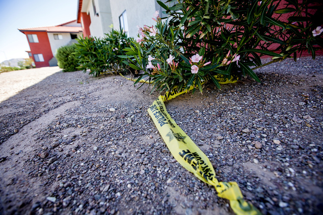 Police tape is seen Tuesday, April 26, 2016 at the Liberty Village Apartment complex. Officers are investigating a April 24 homicide in the area. Jeff Scheid/Las Vegas Review-Journal Follow @jlscheid