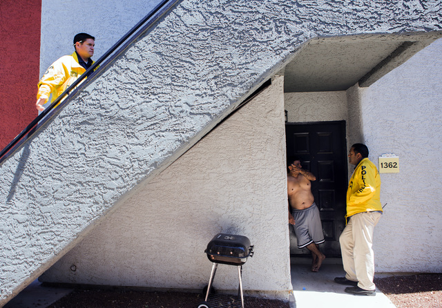 Officers Jesus Jimenez, left, and Antonio Munoz  with Northeast area command Community Policing unit talks to a man in the Liberty Village Apartment complex on Tuesday, April 26, 2016.  Officers a ...