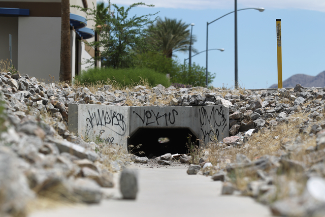 Graffiti covers a drainage cover off of East Craig Road near Nellis Boulevard in Las Vegas on Friday, April 29, 2016.  (Brett Le Blanc/Las Vegas Review-Journal) Follow @bleblancphoto