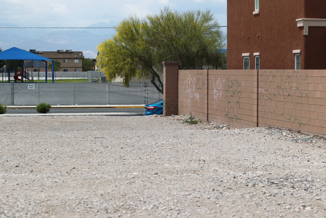 Graffiti covers a wall across the street from J.E. Manch and Zel & Mary Lowman Elementary Schools in Las Vegas on Friday, April 29, 2016. A schoolyard is seen in the background.  (Brett Le Bla ...