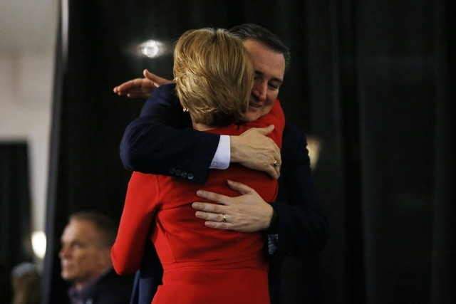 Republican presidential candidate Sen. Ted Cruz, R-Texas, hugs Carly Fiorina before speaking during a rally, Wednesday, April 20, 2016, at the Antique Automobile Club of America Museum in Hershey, ...