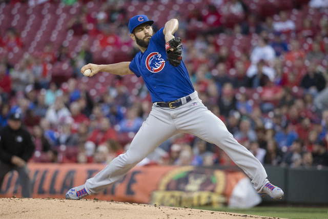 Chicago Cubs starting pitcher Jake Arrieta throws in the first inning of a baseball game against the Cincinnati Reds on Thursday, April 21, 2016, in Cincinnati. (John Minchillo/The Associated Press)