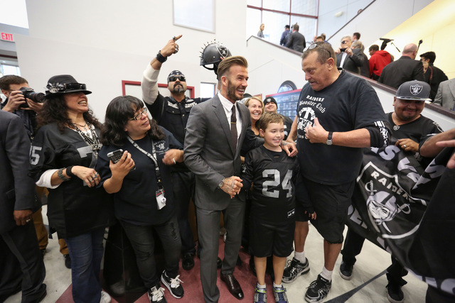 David Beckham poses for a photo with Oakland Raiders fans during a Southern Nevada Tourism Infrastructure Committee meeting at UNLV in Las Vegas on Thursday, April 28, 2016. (Brett Le Blanc/Las Ve ...