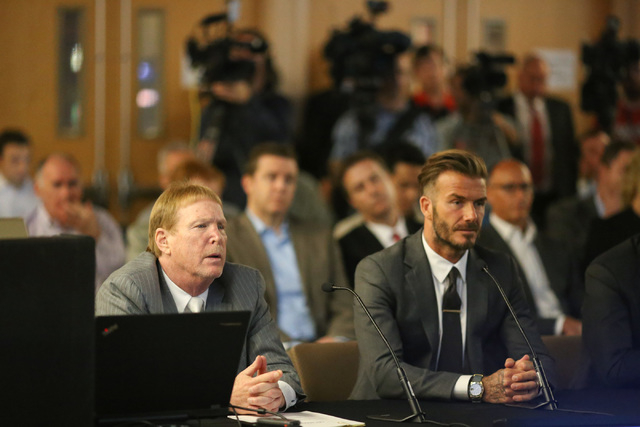 David Beckham, right, and Oakland Raiders owner Mark Davis, left, speak with the Southern Nevada Tourism Infrastructure Committee about a multi-use stadium during a meeting at UNLV in Las Vegas on ...