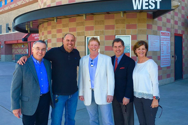 UNLV adviser Don Snyder, UNLV football coach Tony Sanchez, Oakland Raiders owner Mark Davis, UNLV President Len Jessup and UNLV athletic director Tina Kunzer-Murphy are seen in front of UNLV's Sam ...