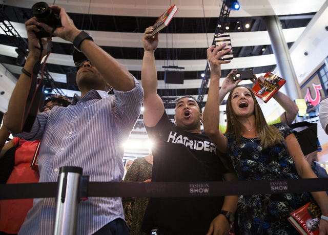 Marnel Estepa, middle, and Michelle Baker, right, cheer for Daymond John at Fashion Show Mall, Wednesday, April 20, 2016, in Las Vegas. Benjamin Hager/Las Vegas Review-Journal
