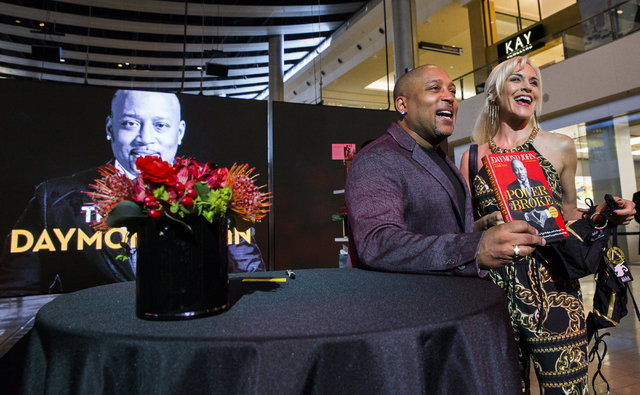 "Daymond John, left, creator of FUBU and star of ABC's ""Shark Tank,"" takes a photo with Ella Mental at Fashion Show Mall, Wednesday, April 20, 2016, in Las Vegas. Benjamin Hager/L ..."