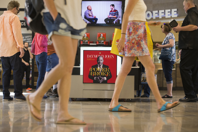 Shoppers walk by Daymond John's new pop up kiosk, Wednesday, April 20, 2016, at Fashion Show Mall, in Las Vegas. Benjamin Hager/Las Vegas Review-Journal