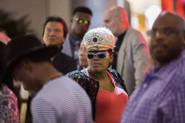 "Brenda Phillips, middle, waits in line to meet Daymond John, creator of FUBU and star of ABC's ""Shark Tank,"" at Fashion Show Mall, Wednesday, April 20, 2016, in Las Vegas. Benjam ..."