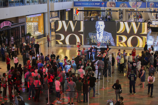 "Fans wait in line to meet Daymond John, middle, creator of FUBU and star of ABC's ""Shark Tank,"" at Fashion Show Mall, Wednesday, April 20, 2016, in Las Vegas. Benjamin Hager/Las  ..."