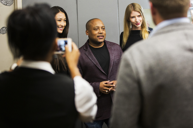 "Daymond John, middle, creator of FUBU and star of ABC's ""Shark Tank,"" takes photos with fans at Fashion Show Mall, Wednesday, April 20, 2016, in Las Vegas. Benjamin Hager/Las Veg ..."