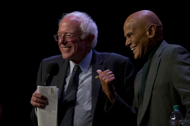 Sen. Bernie Sanders, I-Vt., is joined on stage by Harry Belafonte as he speaks at a campaign event at the Apollo Theatre, Saturday, April 9, 2016, in the Harlem neighborhood of Manhattan. (Mary Al ...